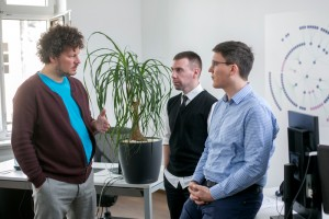 Three people talking in an office