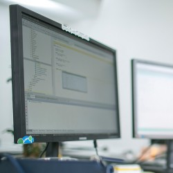 Monitor displaying software development code